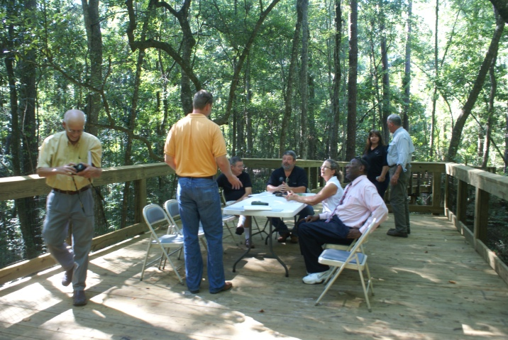 Monticello Ecological Park Committee meeting on the bridge